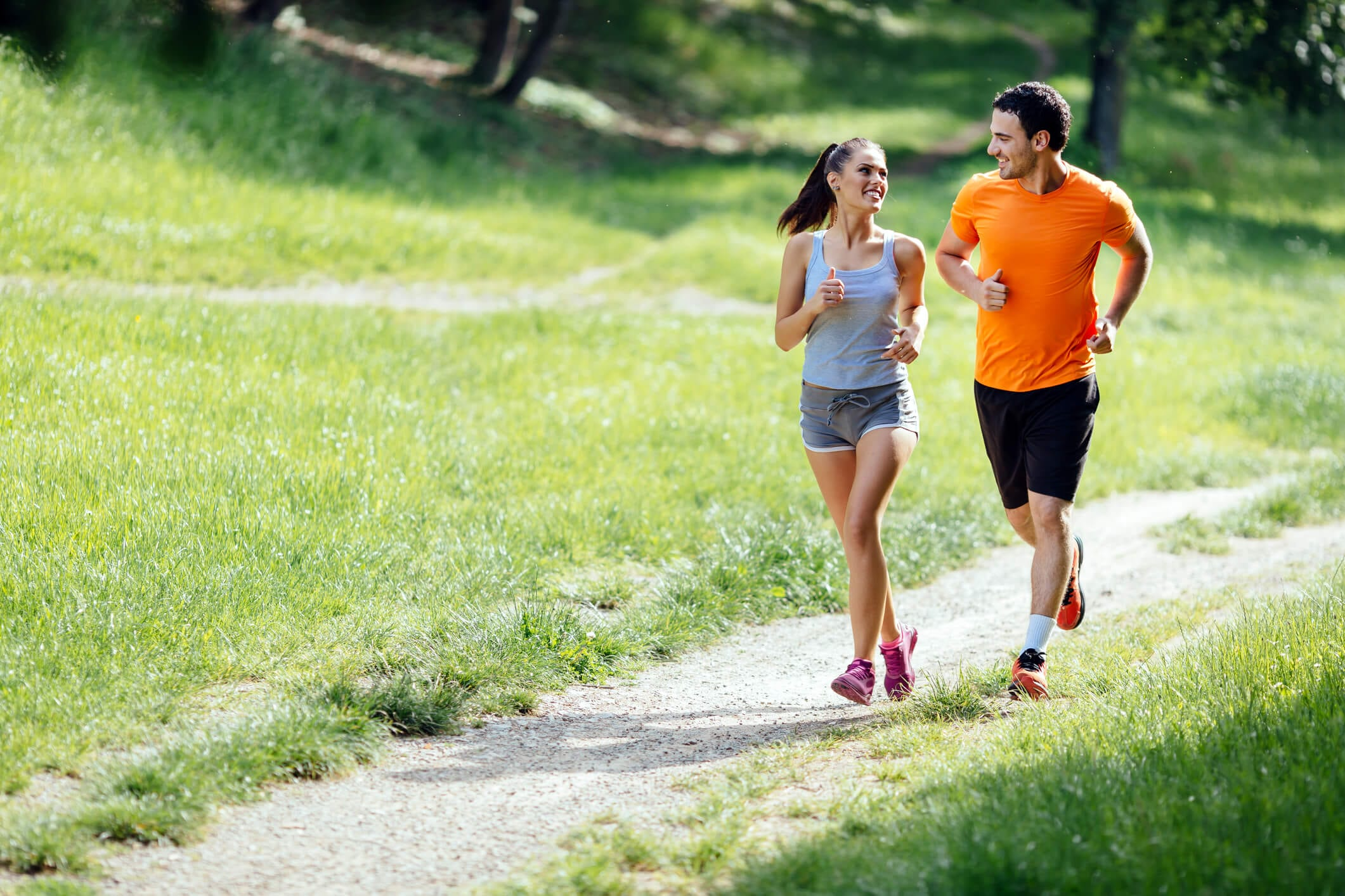 Beautiful couple jogging in nature.