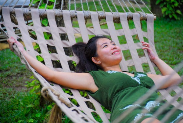 Sweet and relaxed Asian Chinese woman on her 20s wearing green