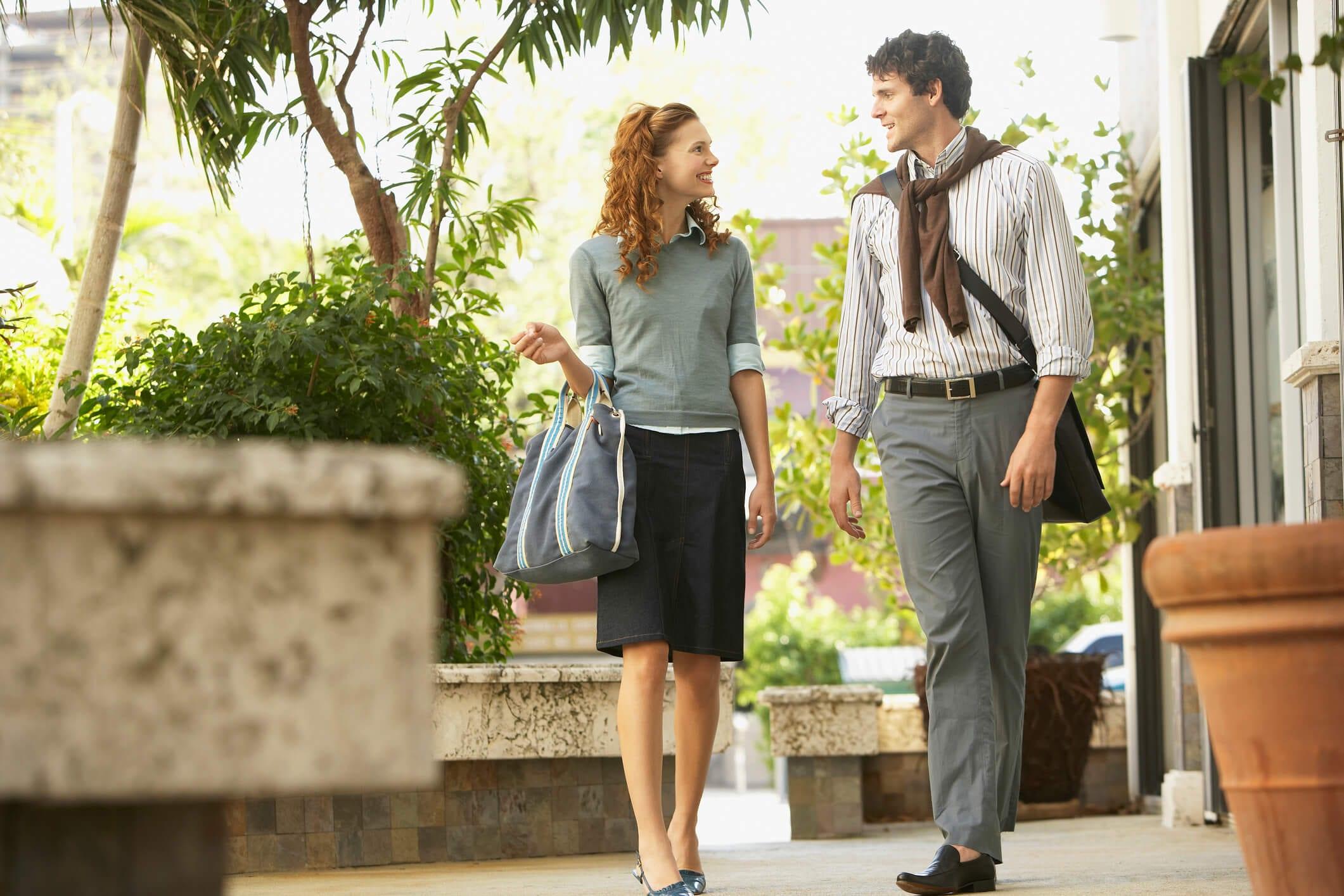 Happy Business People Walking On Sidewalk.
